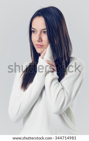 Young teenager brunette girl candid studio portrait - stock photo