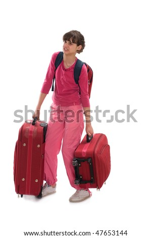 Young teenager carry heavy huge luggages - stock photo