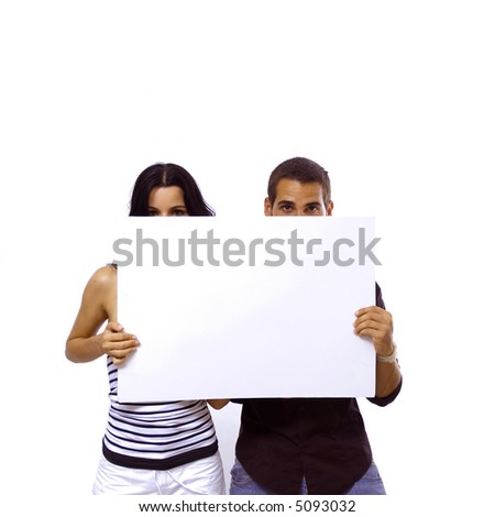 Young teenager couple holding a blank banner - isolated over white