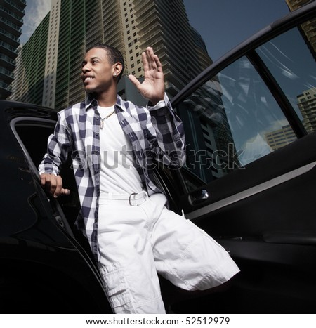 Young teenager exiting the vehicle - stock photo