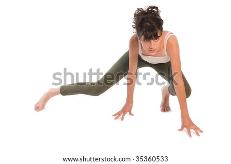 Young teenager girl practicing gymnastic on white - stock photo