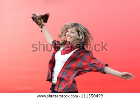 young teenager girl with old film camera against red background - stock photo
