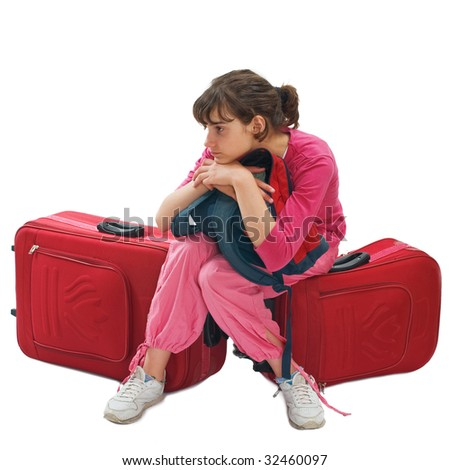 Young teenager sitting on huge luggage waiting transportation - stock photo