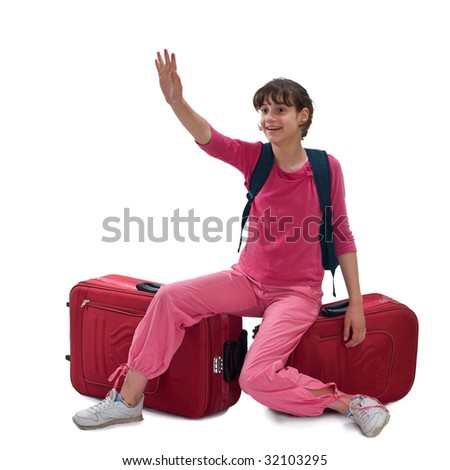 Young teenager sitting on huge luggages and waves for a taxi - stock photo