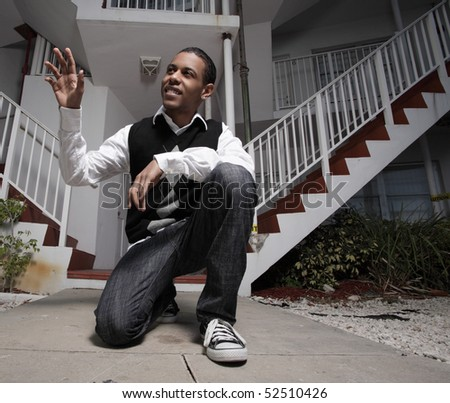 Young teenager waving and smiling - stock photo