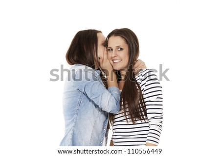 young teenager whispering chit-chat to her laughing friend on white background - stock photo