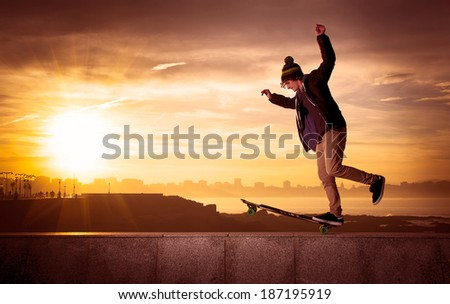 young teenager with a longboard - stock photo