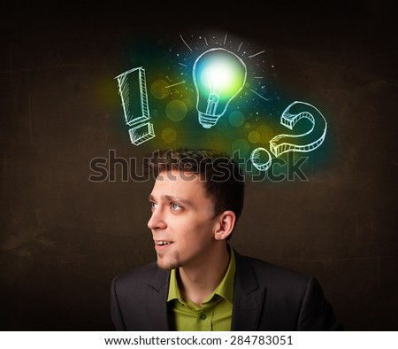 Young teenager with hand drawn light bulb illustration  - stock photo
