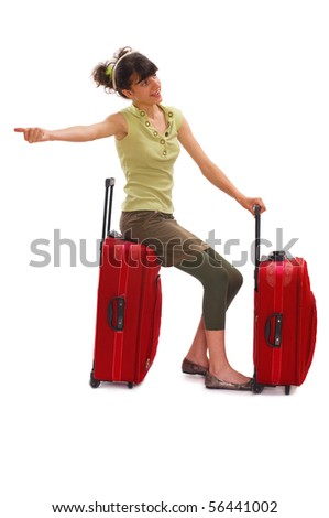 Young teenager with huge luggage and waves for a taxi - stock photo