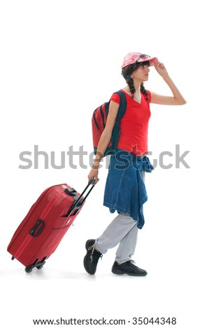 Young teenager with huge luggage besides her on the travel - stock photo
