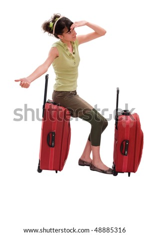 Young teenager with huge luggage hitchhike - stock photo