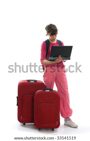 Young teenager with huge luggage searching on notebook location for traveling - stock photo