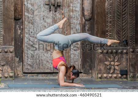 Young teenager women practicing Yoga and stretching workout exercise in yoga class