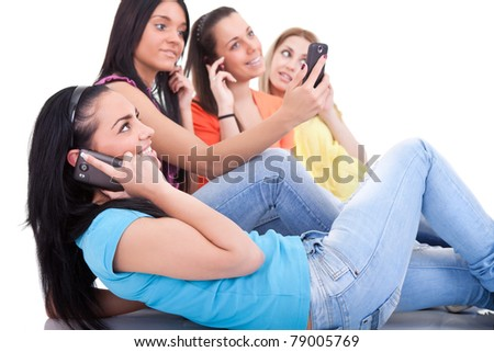 young teenagers using cell phones,  isolated white background - stock photo