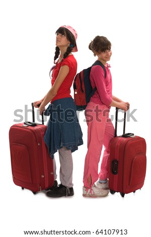 Young teenagers with huge luggage besides her on the travel - stock photo
