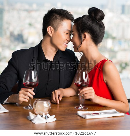 Young tender couple during the romantic date at a cafe  - stock photo