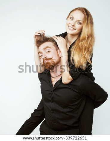 young tender couple, man and woman in love isolated on white close up kissing smiling fooling around - stock photo