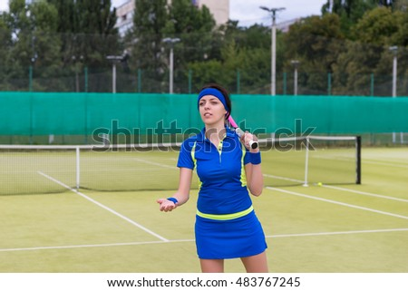 Young tennis player holding racket preparing for playing game on outdoor court during summer