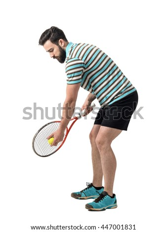 Young tennis player in polo shirt preparing to serve ball. Full body length portrait isolated over white studio background. - stock photo