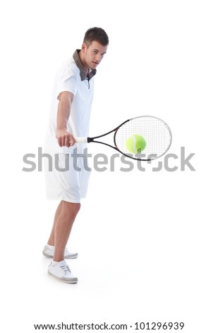 Young tennis player prepared for backhand stroke. - stock photo