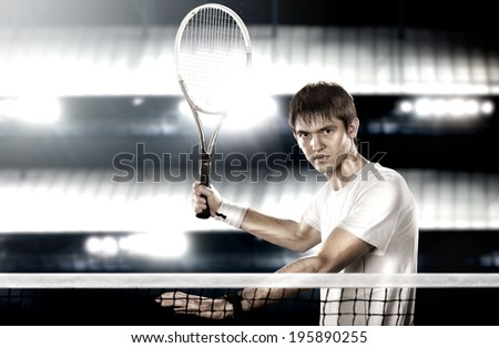Young tennis player with racket ready to hit a tennis ball - stock photo