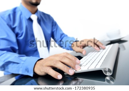 young Thai man working with computer - stock photo