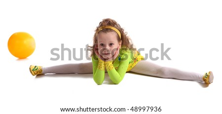 young the girl-gymnast do the splits  on white ground - stock photo