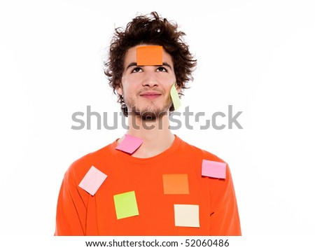young thinking caucasian man portrait in studio on white background - stock photo