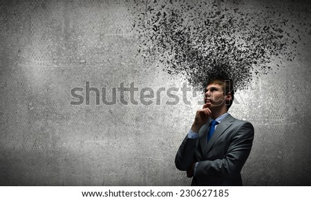 Young thoughtful businessman and thoughts above his head