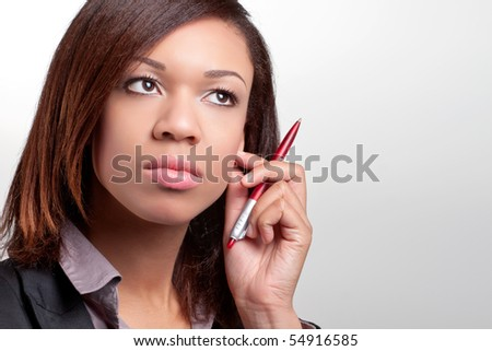 Young thoughtful businesswoman