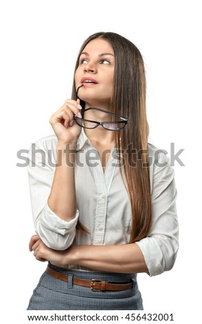 Young thoughtful businesswoman looking upwards with glasses in her arm isolated on the whire background. Business staff. Office clothes. Ideas and concepts. Contemplations and reflections. - stock photo