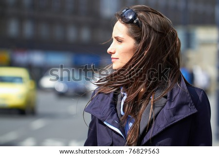young thoughtful female, city centre location, monochrome photograph - stock photo