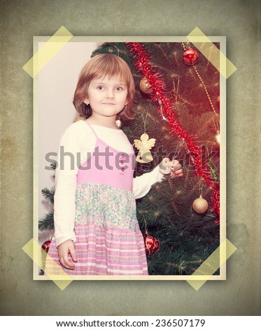 young thoughtful girl with Christmas tree - vintage picture on grunge background with stick papers - stock photo