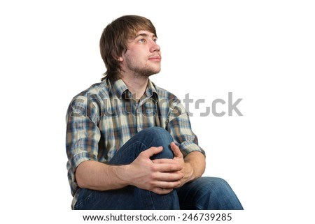 Young thoughtful guy in casual isolated on white background - stock photo