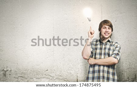 Young thoughtful handsome man in casual thinking over the ideas - stock photo