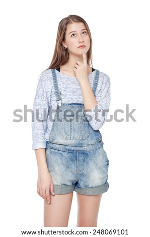 Young thoughtful teenage girl looking on something isolated on white background - stock photo
