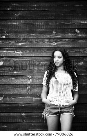 Young thoughtful woman in abandoned house - stock photo