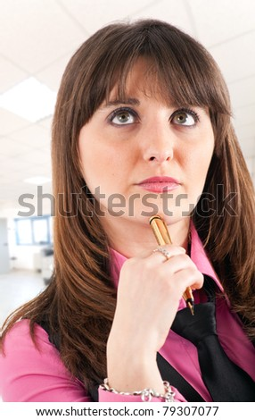 Young thoughtful woman portrait in an office environment - stock photo