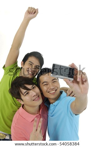 Young three asian man taking a photo of themselves - stock photo
