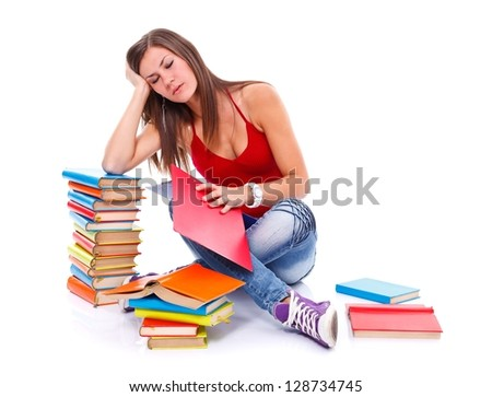 Young tired student woman surrounded with books, isolated over white background