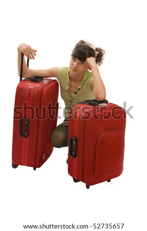 Young tired teenager girl with huge luggage - stock photo