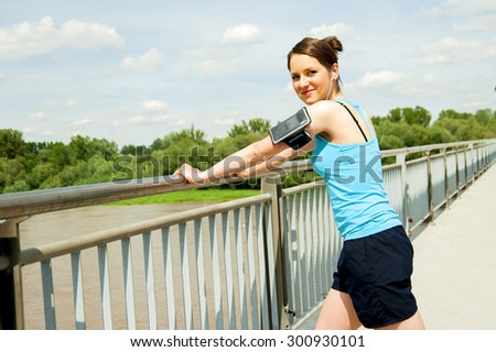 Young tired woman rest after run in the city over the bridge. - stock photo