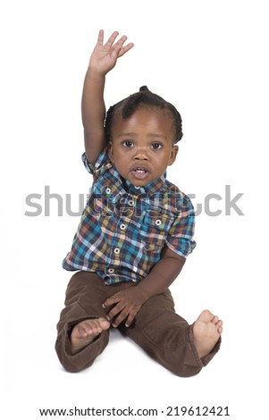 Young toddler looking to his left isolated