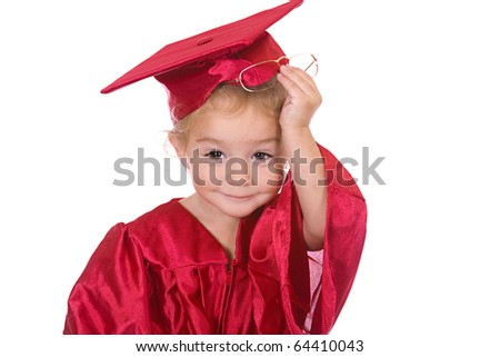 Young toddler scholar dressed in graduation cap and gown. - stock photo