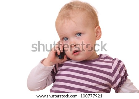 Young toddler with cell phone on white background - stock photo