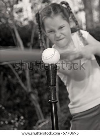 Young Tomboy Girl at Bat Hitting Ball - stock photo