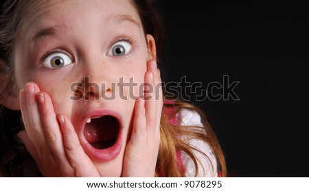 Young Toothless Girl in Awe - stock photo