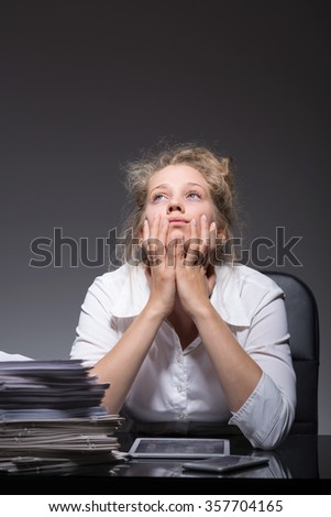 Young totally burnout woman at work place - stock photo