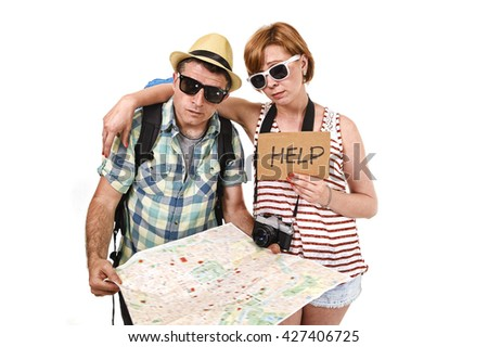 young tourist couple reading city map looking lost and confused loosing orientation with girl carrying travel backpack and man in frustrated face expression asking for help isolated in white - stock photo