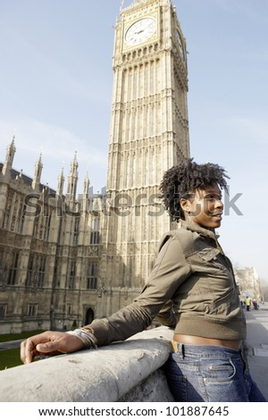Young tourist standing by Big Ben in London city. - stock photo